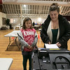 Tuesday the candidates were out holding signs at the polls in Fitchburg, Nov. 5, 2019. Jaylyn Stacey, 9, watches as her mom Amanda Carr cast her ballot as the polls inside the Fitchburg Senior Center. SENTINEL & ENTERPRISE/JOHN LOVE