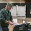 Tuesday the candidates were out holding signs at the polls in Fitchburg, Nov. 5, 2019. Donald LeBlanc puts his ballot into the ballot box as he cast his vote at the Senior Center. SENTINEL & ENTERPRISE/JOHN LOVE