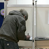 Tuesday the candidates were out holding signs at the polls in Fitchburg, Nov. 5, 2019. A voter fills out his ballot at the polls at the Senior Center. SENTINEL & ENTERPRISE/JOHN LOVE