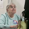 Tuesday the candidates were out holding signs at the polls in Fitchburg, Nov. 5, 2019. Checking in a voter at the polls at the St. Bernard's Activity Center was Inspector Judy Miller. SENTINEL & ENTERPRISE/JOHN LOVE