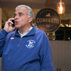 Mayor Dean Mazzarella at his campaign party at Comeketo Brazilian Steak House after the polls closed on Tuesday in Leominster talks on the phone to a supporter that could not make it. SENTINEL & ENTERPRISE/JOHN LOVE