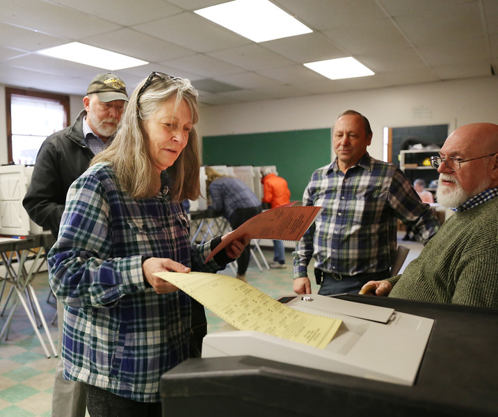 HOLLY PELCZYNSKI - BENNINGTON BANNER Cindy Love turns in her ballot on Tuesday morning at the Pownal Fire Department during Primary day in Vermont.