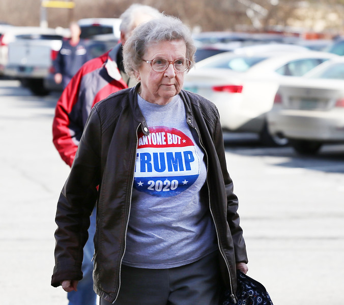 """HOLLY PELCZYNSKI - BENNINGTON BANNER Francis Hicks, of Bennington marches into the Bennington Fire house, prepared to cast her vote wearing a """"Anyone but Trump 2020"""" Tee shirt on Tuesday afternoon during primary day in Bennington."""