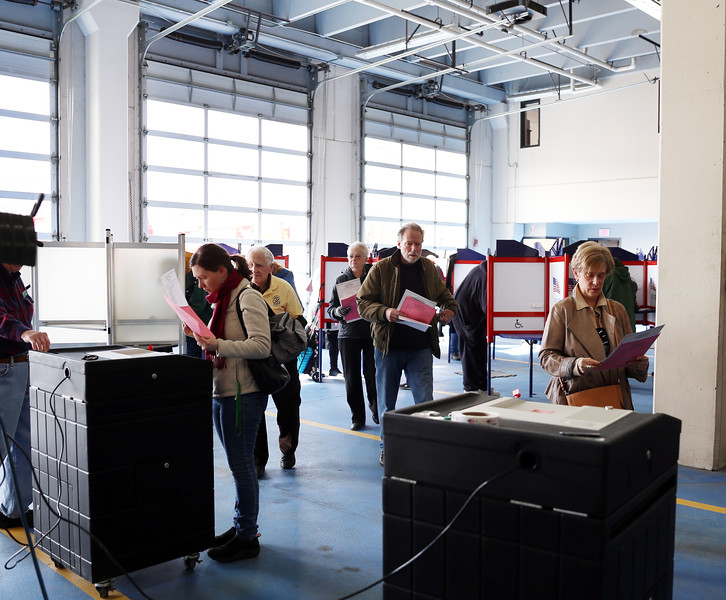 HOLLY PELCZYNSKI - BENNINGTON BANNER Bennington residents race to hand in their ballot on Tuesday afternoon at the Bennington Fire House during voting day in Vermont.