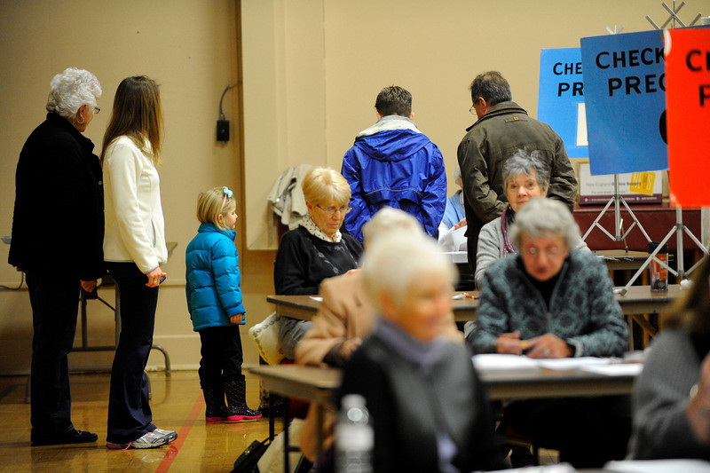 Lunenburg residents sign in to vote for the funding mechanism for a new middle high school, Saturday at the T.C. Passios Elementary School.<br /> SENTINEL & ENTERPRISE / BRETT CRAWFORD