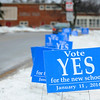 Signs line the entrance to T.C. Passios Elementary School where Lunenburg residents voted for the funding mechanism for a new middle high school, Saturday.<br /> SENTINEL & ENTERPRISE / BRETT CRAWFORD