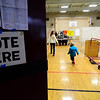 Lunenburg residents arrive in the gymnasium at T.C. Passios Elementary School to vote for the funding mechanism for a new middle high school, Saturday.<br /> SENTINEL & ENTERPRISE / BRETT CRAWFORD