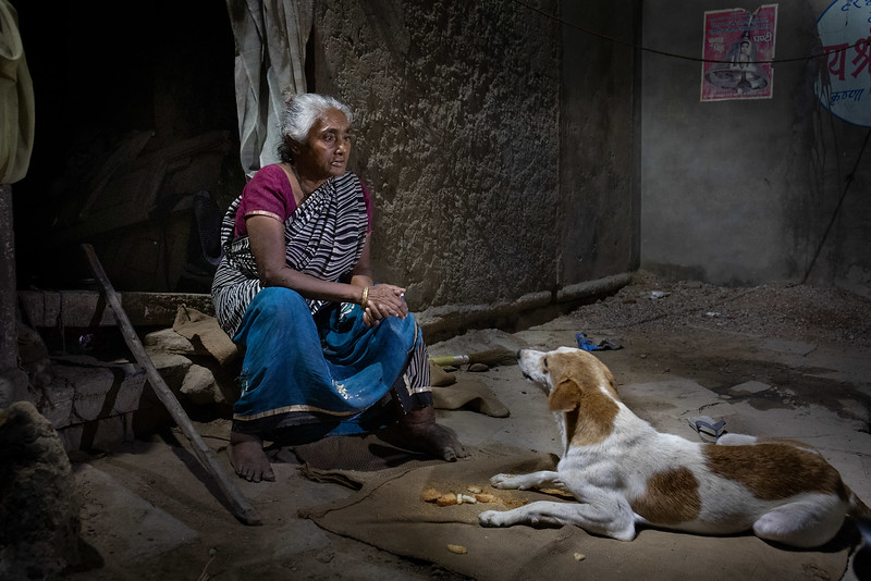 Dulari, one of the widows of Vrindavan, outside her small home.
