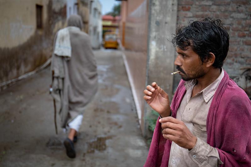 Having a smoke. Carrying water back home. Near the Sukhdha Bhakti Ashram.