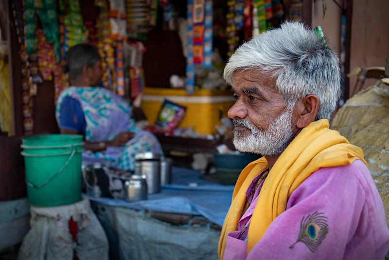 Having a rest at a tea stall. Bhaktivedanta Swami Marg.