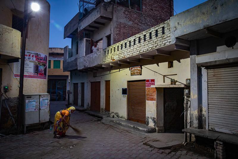 Cleaning the steets of Vrindavan just before dawn. Chaitanya Vihar.