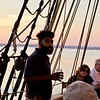 A young crew member relates to  passengers the story of the original Amistad and the cruelties the slaves endured.