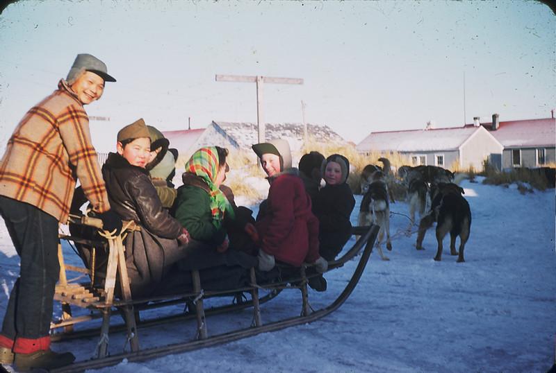 Dogsled with passengers, Egegik, Alaska