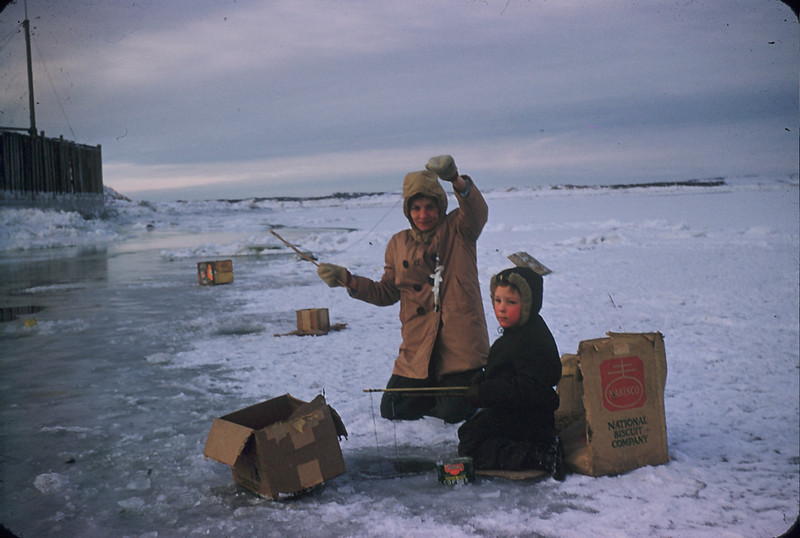 Mother and brother, fishing through the ice, Alaska. 1955.