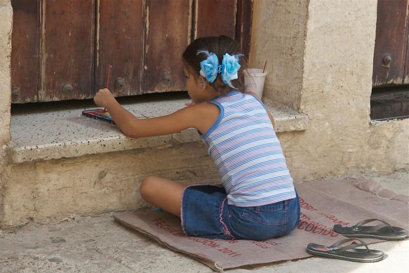 a schoolgirl paints