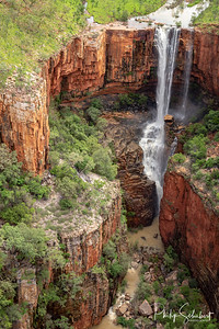 Aerial Portrait view of spectacular double drop unamed waterfall in the Cockburn Ranges, El Questro Resort, Kimberley, Western Australia.
