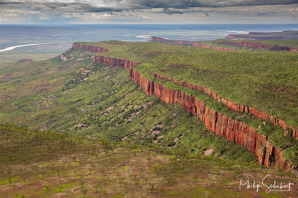 Wide angle aerial view of the iconic cliffs and high plateau of the Cockburn Range, El Questro Station, Kimberley, Australia.