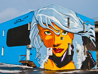 "THA PHLASH - CUBE GIRL ""This mural was made in 2009, in Montreal, Verdun on 3 face of the building. Great fun cube-inspired for my friends at cubecommunity.ca you may notice that i luv my car. A very intense 6 days production with temperature flirting with 0, i rarely paint outside this late in the seasons but i couldn't hold myself!"""
