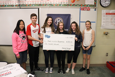 Accepting on behalf of the Make-a-Wish Foundation is WAHS student Zoe Wagner, third from left, who conducts a number of fundraisers for the organization locally.  From left are Builders Club members Marcella Fisher, Caleb Fausnaught, Mychal Flanigan, Savannah Grove, and Sarah Spring.