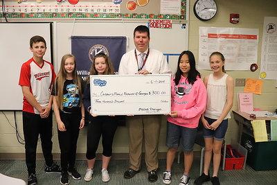 WAMS Head Principal Dr. Justin Ross, center, stands in to accept a $300 donation to the Children's Miracle Network at Geisinger on behalf of the hospital system.  From left are Builders Club members Caleb Fausnaught, Mychal Flanigan, Savannah Grove, Marcella Fisher and Sarah Spring.