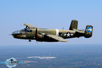 B-25 TONDELAYO OF THE COLLINGS FOUNDATION CIRCLES AFTER DEPARTING BURLINGTON-ALAMANCE REGIONAL AIRPORT