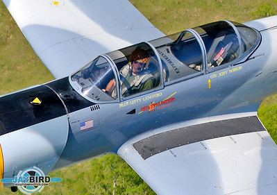 SMILE! A CLOSEUP OF ROBERT LANGFORD, FLYING HIS NANCHANG CJ-6A AT ABOUT 1,000 FEET AGL OVER LEBANON, TN.  THANKS TO DAVID WILLIAMS WHO FLEW MY CHASE SHIP, A MAULE WITH THE REAR DOOR REMOVED.