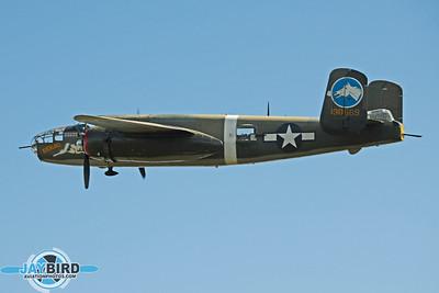 B-25 TONDELAYO OF THE COLLINGS FOUNDATION CIRCLES AFTER DEPARTING BURLINGTON-ALAMANCE REGIONAL AIRPORT