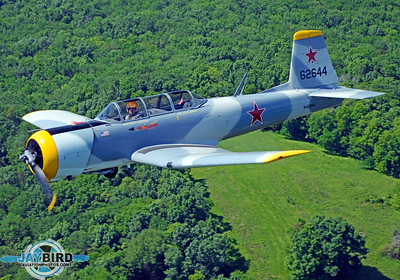 ROBERT LANGFORD'S NANCHANG CJ-6A AT ABOUT 1,000 FEET AGL OVER LEBANON, TN.  THANKS TO DAVID WILLIAMS WHO FLEW MY CHASE SHIP, A MAULE WITH THE REAR DOOR REMOVED.