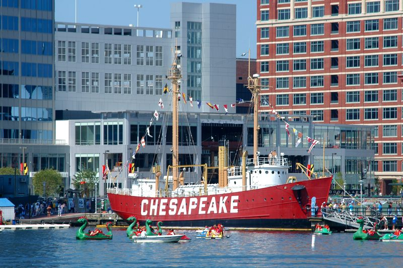 Little and large boat occupy the waters of Baltimore Inner Harbor