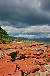 Island of Bute shore.  This red sandstone was used for many buildings on the island.