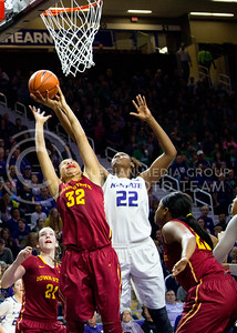 Senior center Breanna Lewis jumps to throw the ball into the basket scoring another win during the K-State game against Iowa State in Bramlage Coliseum on Feb. 11 2017 where the Wildcats beat the Cardinals 80-68. (Alanud Alanazi | The Collegian)