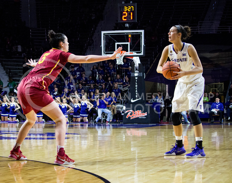 Junior forward Kaylee Page tries to pass the ball to her teammates during the K-State game against Iowa State in Bramlage Coliseum on Feb. 11 2017 where the Wildcats beat the Cardinals 80-68. (Alanud Alanazi   The Collegian)