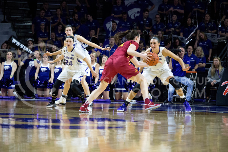 Junior forward Kaylee Page triesto block a player from Iwoa State during the K-State game against Iowa State in Bramlage Coliseum on Feb. 11 2017 where the Wildcats beat the Cardinals 80-68. (Alanud Alanazi | The Collegian)