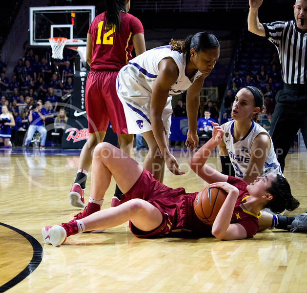 Junior guard Shaelyn Martin and freshman forward lanie page help a player from Iowa State stand after she fell reaching for the ball during the K-State game against Iowa State in Bramlage Coliseum on Feb. 11 2017 where the Wildcats beat the Cardinals 80-68. (Alanud Alanazi | The Collegian)