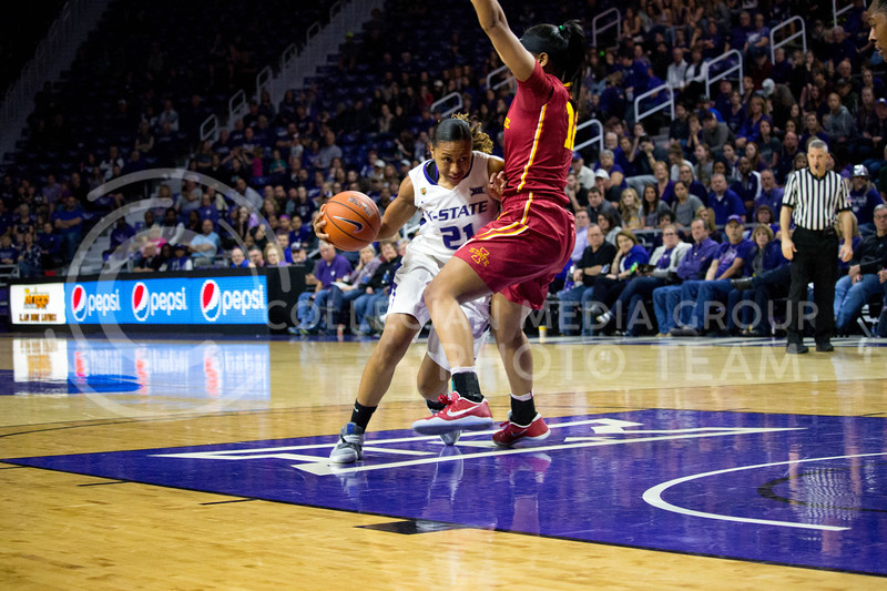 Junior guard Karyla Middlebrook pushes a player from the oppsite team away from her during the K-State game against Iowa State in Bramlage Coliseum on Feb. 11 2017 where the Wildcats beat the Cardinals 80-68. (Alanud Alanazi | The Collegian)