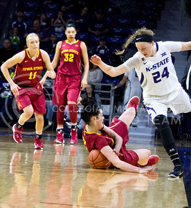 Senior gaurd Kindred Wesemann regains her balance after a player from Iowa State falls reaching for the ball during the K-State game against Iowa State in Bramlage Coliseum on Feb. 11 2017 where the Wildcats beat the Cardinals 80-68. (Alanud Alanazi | The Collegian)