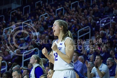 Senior guard Kelly Thomson cheers during the K-State game against Texas in Bramlage Coliseum on February 27, 2017. (Maddie Domnick | The Collegian)