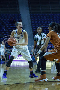 Junior forward Kaylee Page looks to pass the ball during the K-State game against Texas in Bramlage Coliseum on February 27, 2017. (Maddie Domnick | The Collegian)