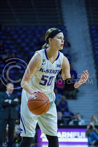 Junior guard Shaelyn Martin dribbles the ball during the K-State game against Texas in Bramlage Coliseum on February 27, 2017. (Maddie Domnick | The Collegian)