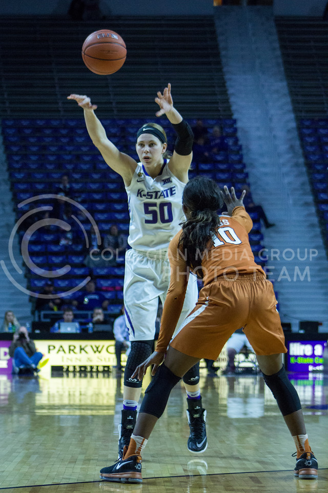 Junior guard Shaelyn Martin passes the ball during the K-State game against Texas in Bramlage Coliseum on February 27, 2017. (Maddie Domnick | The Collegian)