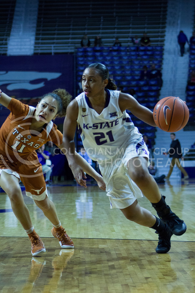 Junior guard Karyla Middlebrook dribbles the ball during the K-State game against Texas in Bramlage Coliseum on February 27, 2017. (Maddie Domnick | The Collegian)