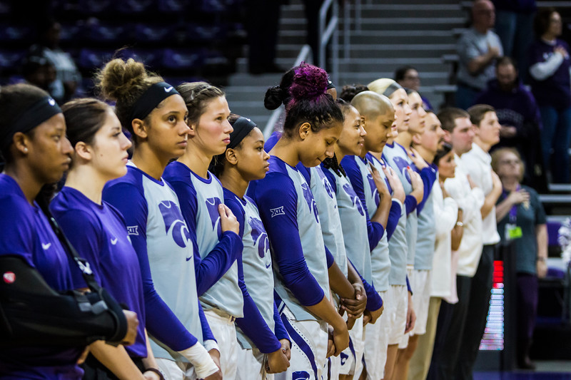 The K-State women's basketball team stands for the national anthem before their game against Lamar in Bramlage Coliseum on Dec. 5, 2018. The Wildcats beat the Cardinals 73-55. (Logan Wassall | Collegian Media Group)