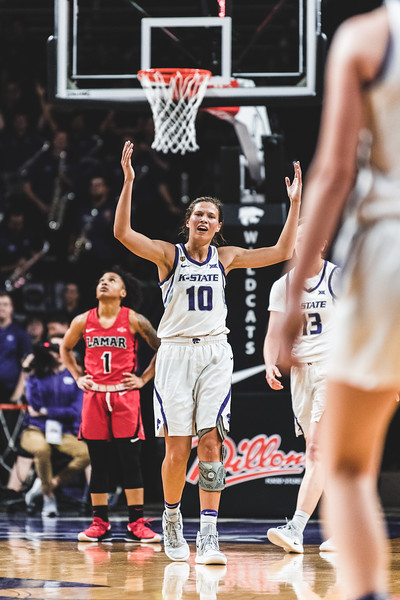 After getting stuck at one end of the court without a teammate to pass to, K-State senior Kayla Goth expresses her frustration on the play. K-State defeated Lamar University 73-55 in Bramlage Coliseum on December 5, 2018. (Alex Todd | Collegian Media Group)