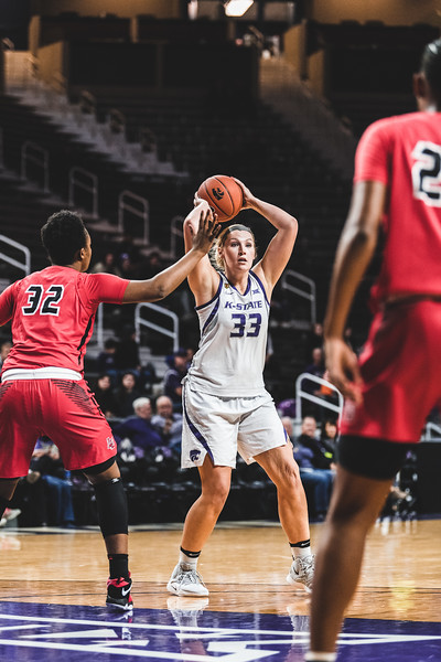 Looking to make a quick play, K-State center Ashley Ray passes the ball to an open teammate. The Wildcats defeated the Lamar Cardinals 73-55 in Bramlage Coliseum on December 5, 2018. (Alex Todd | Collegian Media Group)