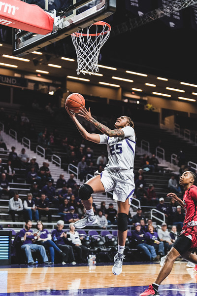 With the Lamar defense behind her, K-State forward Jasauen Beard scores two points for K-State. The Wildcats defeated the Cardinals 73-55 in Bramlage Coliseum on December 5, 2018. (Alex Todd | Collegian Media Group)