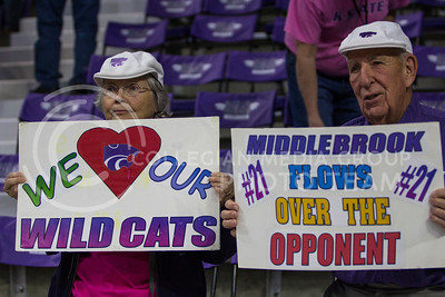 Family members of junior guard, Karyla Middlebrook hold up posters after the game against Oklahoma in Bramlage on Feb. 21, 2017. (Sabrina Cline | The Collegian)