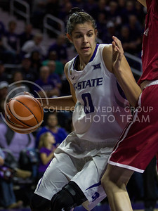Senior forward, Jessica Sheble dribbles into the lane during the K-State game against Oklahoma in Bramlage Coliseum on Feb. 21 2017. (Sabrina Cline | The Collegian)