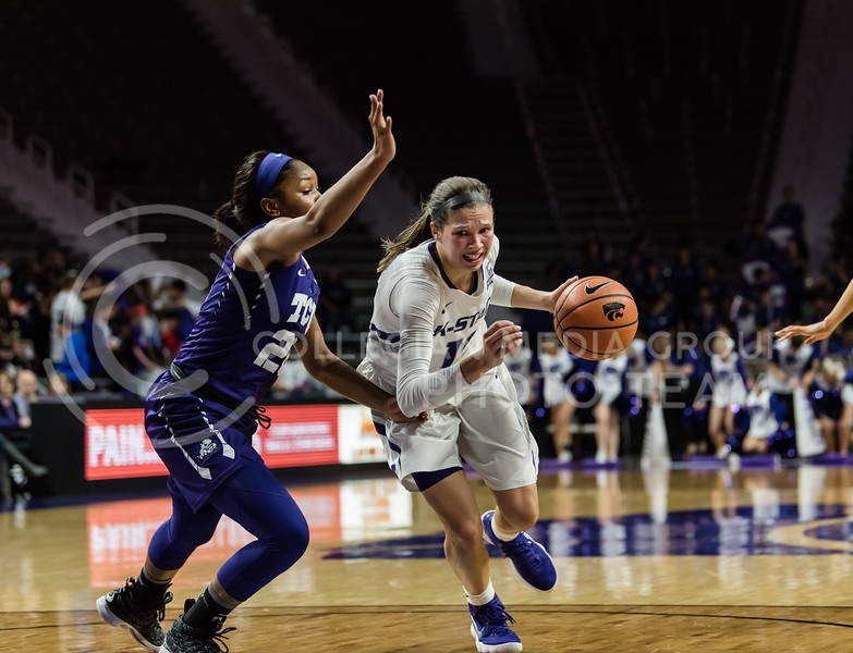 At Bramlage Coliseum, Kansas State Wildcat Kayla Goth aggressively charges the basket against the Texas Christian University Horned Frogs. Wednesday night, the women's basketball team lost with a final score of 63-68. (Olivia Bergmeier | Collegian Media Group)