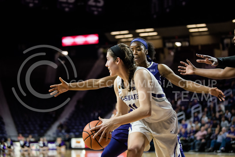 Kansas State Wildcat Peyton Williams looks away from the basket to one of her fellow teammates to pass the ball. The K-State Women's Basketball Team played against the Texas Christian University Horned Frogs at Bramlage Coliseum on Wednesday. (Olivia Bergmeier | Collegian Media Group)
