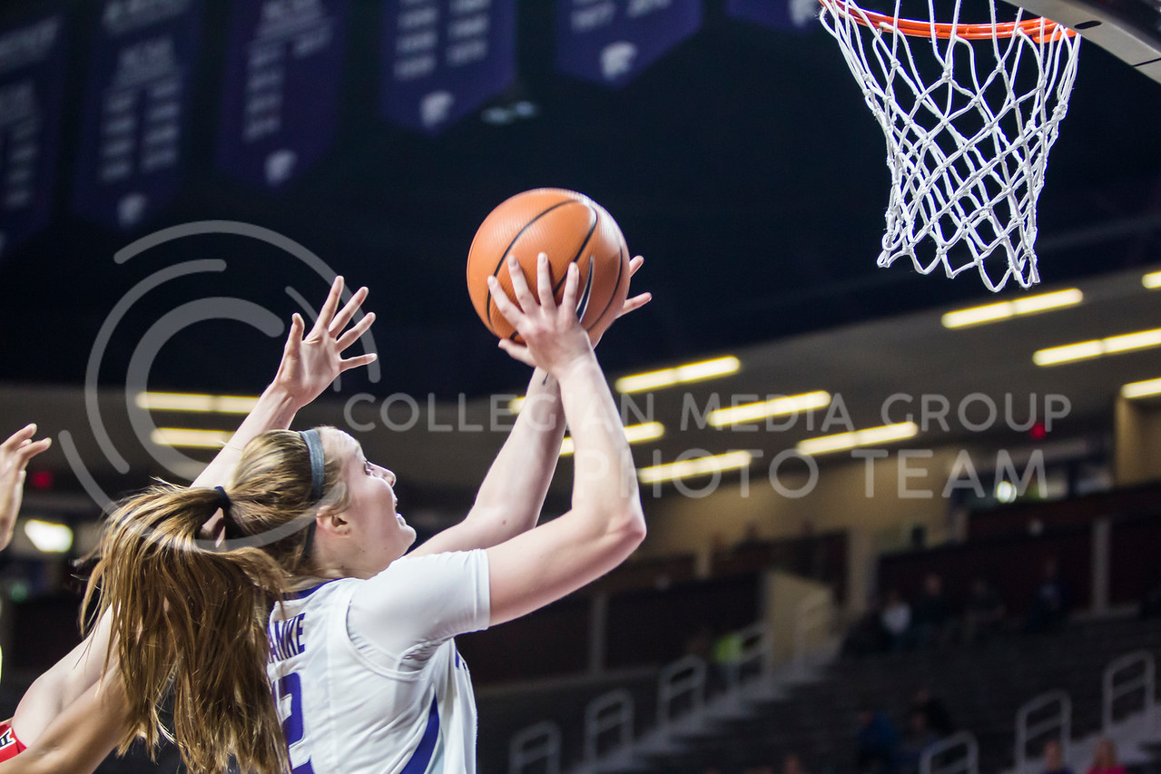 Freshman guard Rachel Ranke jumps for a layup against Texas Tech in Bramlage Coliseum on Feb. 7, 2018. The Wildcats defeated Red Raiders with a final score of 83-69. (Logan Wassall | Collegian Media Group)